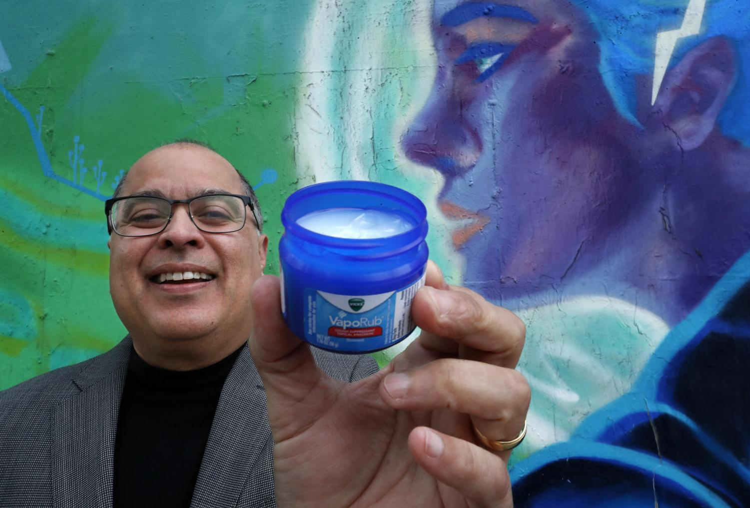 Daniel Olivas holds a jar of Vicks VapoRub near his office in downtown L.A. When Olivas caught a cold as a child, he recalls, his mother pulled the blue jar from the medicine cabinet, slathered the ointment on his chest and put him to bed in a haze of eucalyptus.