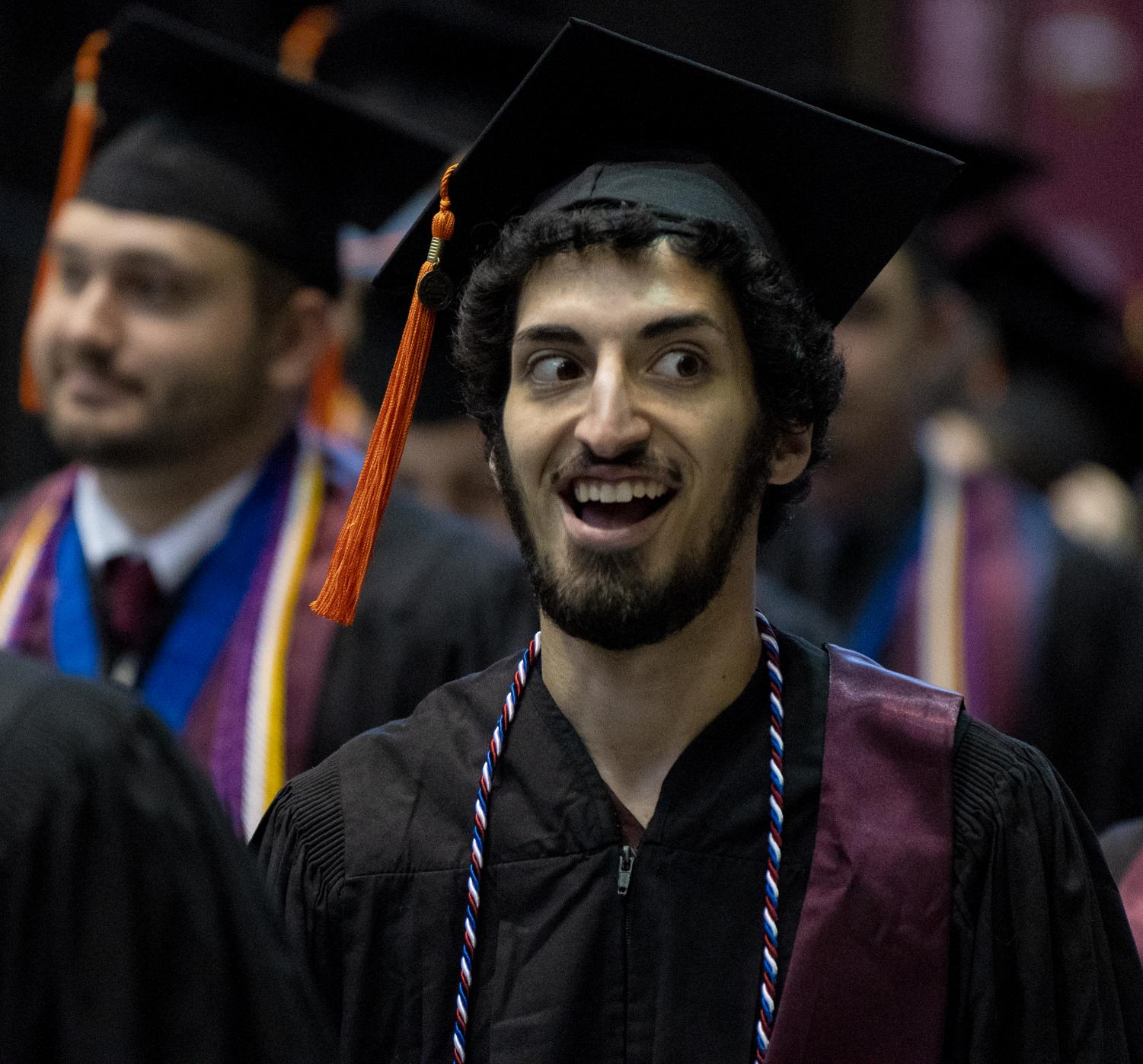Jordan+Robin+reacts+while+walking+into+the+Arena+on+Saturday%2C+May+11%2C+2019+during+the+2019+commencement+inside+the+SIU+Arena.+Robin+graduated+with+a+degree+in+Aviation+Technologies.+