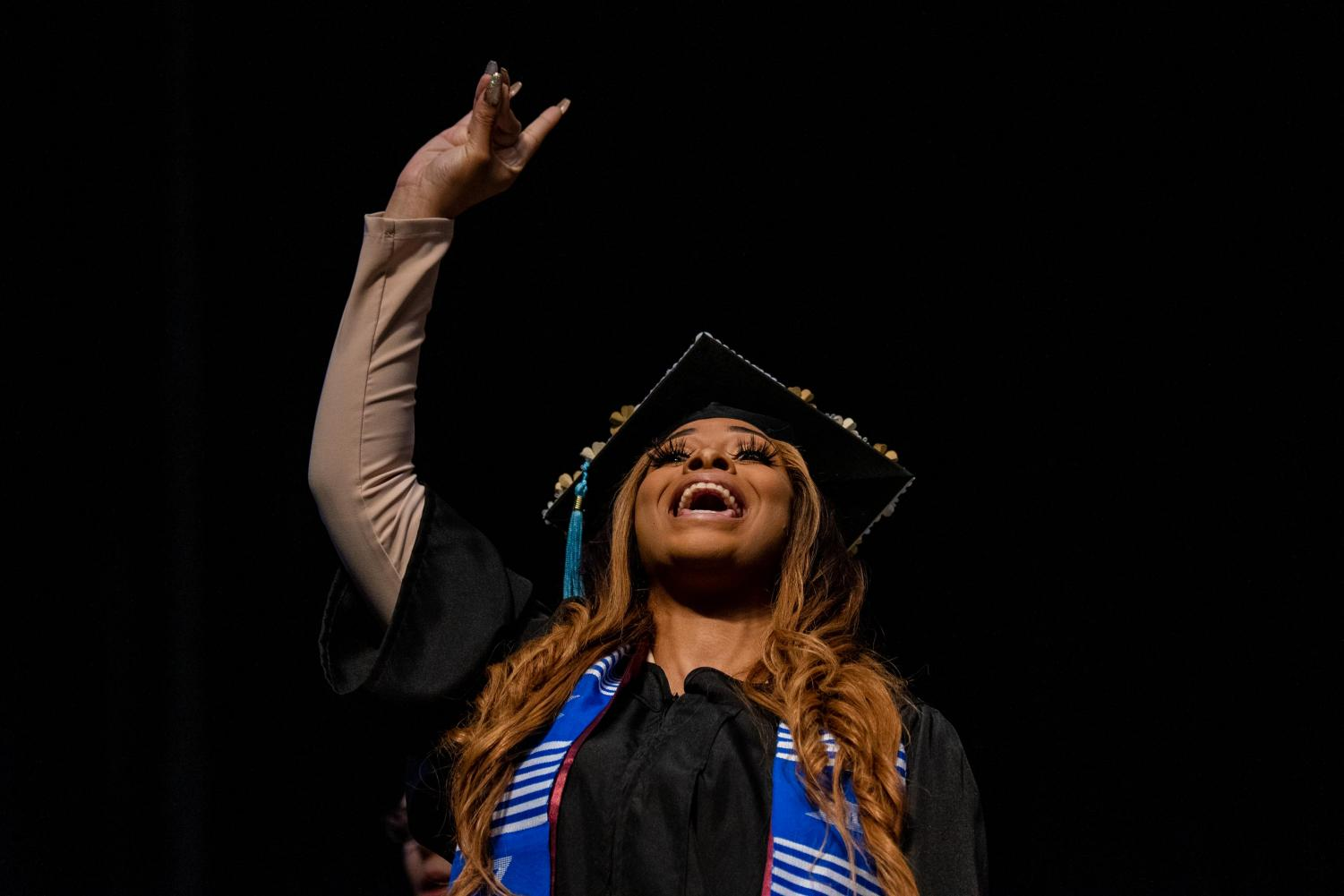Val+Jackson+reacts+after+receiving+her+diploma+on+Saturday%2C+May+11%2C+2019+during+the+2019+commencement+inside+the+SIU+Arena.+