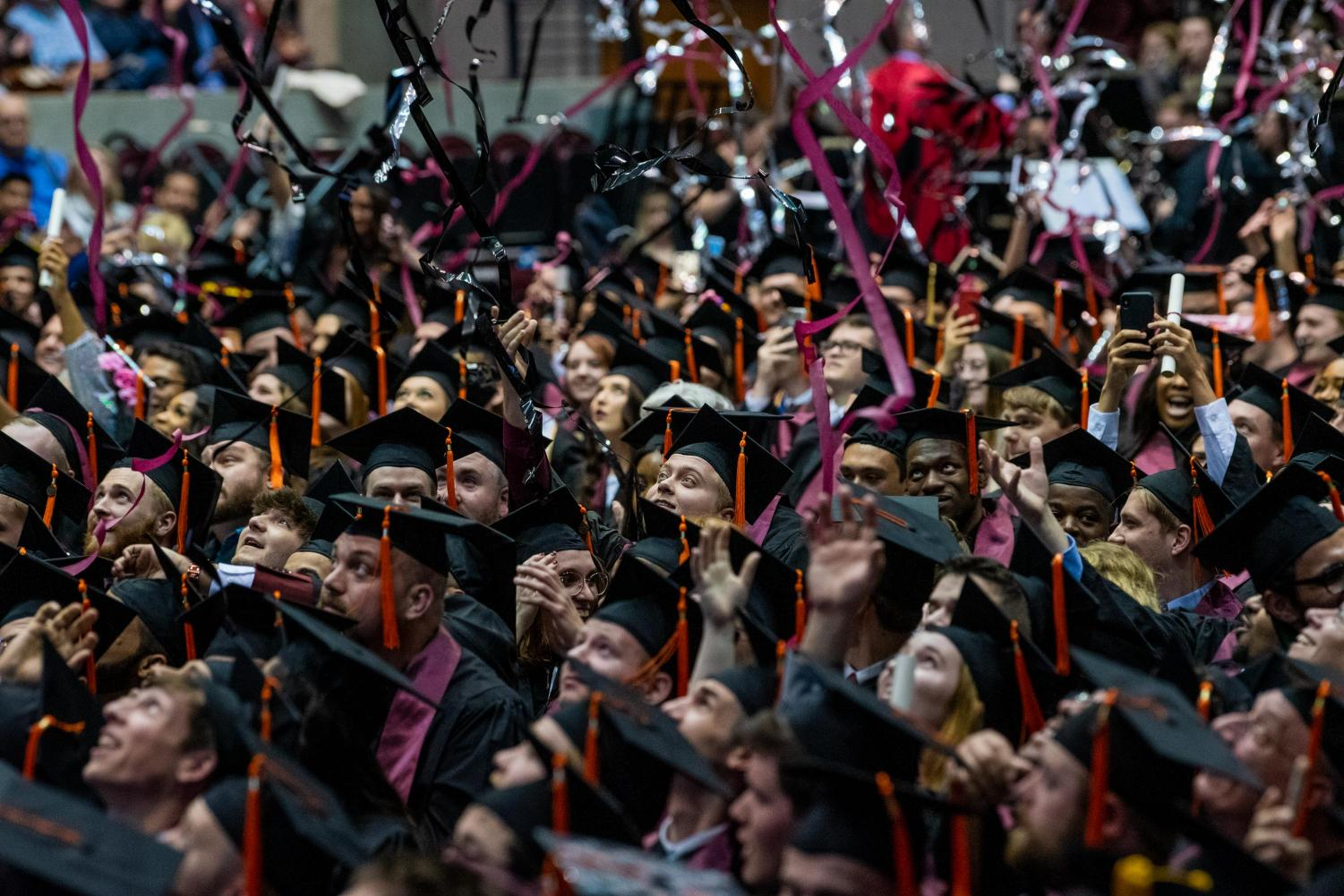 Graduated+students+react+as+confetti+falls+down+on+them+on+Saturday%2C+May+11%2C+2019+during+the+2019+commencement+inside+the+SIU+Arena.+
