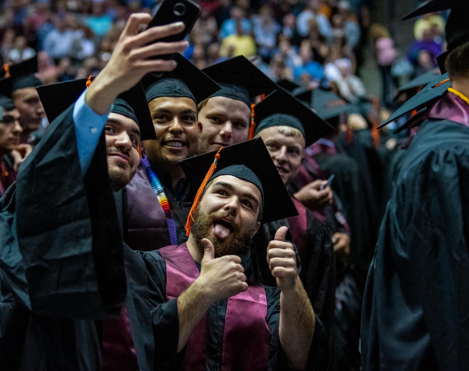 Graduating+students+pose+together+for+a+picture+on+Saturday%2C+May+11%2C+2019+during+the+2019+commencement+inside+the+SIU+Arena.+