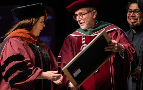 Academy Award nominee, Emmy Award-winning actress Melissa McCarthy receives an honorary doctorate of performing arts degree from Interim Chancellor John Dunn on Saturday, May 11, 2019 during the 2019 commencement inside the SIU Arena.