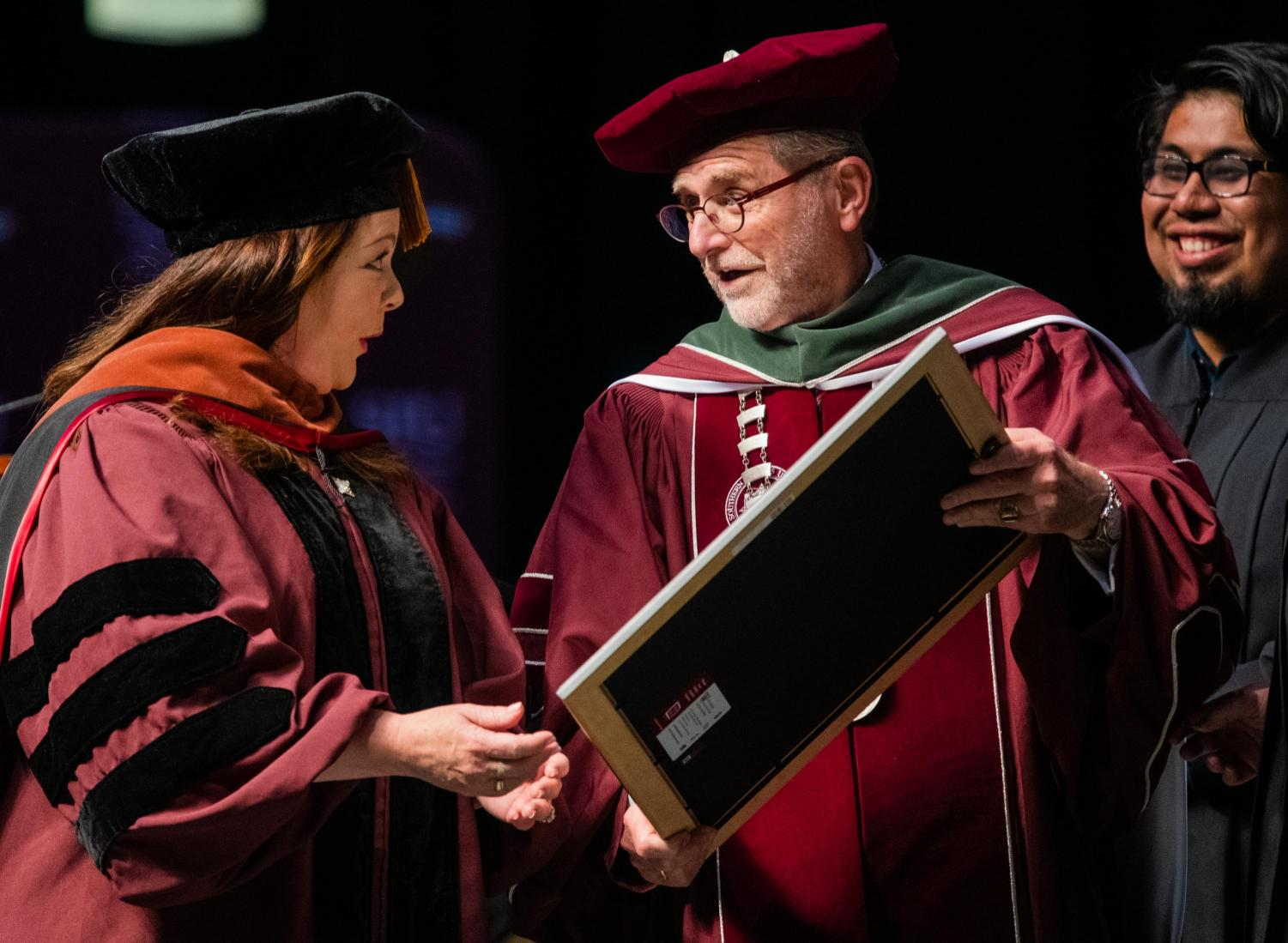 Academy+Award+nominee%2C+Emmy+Award-winning+actress+Melissa+McCarthy+receives+an+honorary+doctorate+of+performing+arts+degree+from+Interim+Chancellor+John+Dunn+on+Saturday%2C+May+11%2C+2019+during+the+2019+commencement+inside+the+SIU+Arena.+
