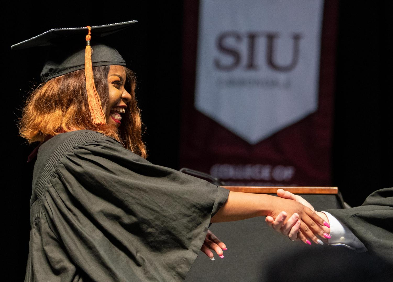 Marie-Esperanoce+Namage+Baseleba+reacts+while+receiving+her+diploma+on+Saturday%2C+May+11%2C+2019+during+the+2019+commencement+inside+the+SIU+Arena.+Baseleba%2C+from+the+Democratic+Republic+of+Congo%2C+received+her+degree+in+Computer+Engineering.