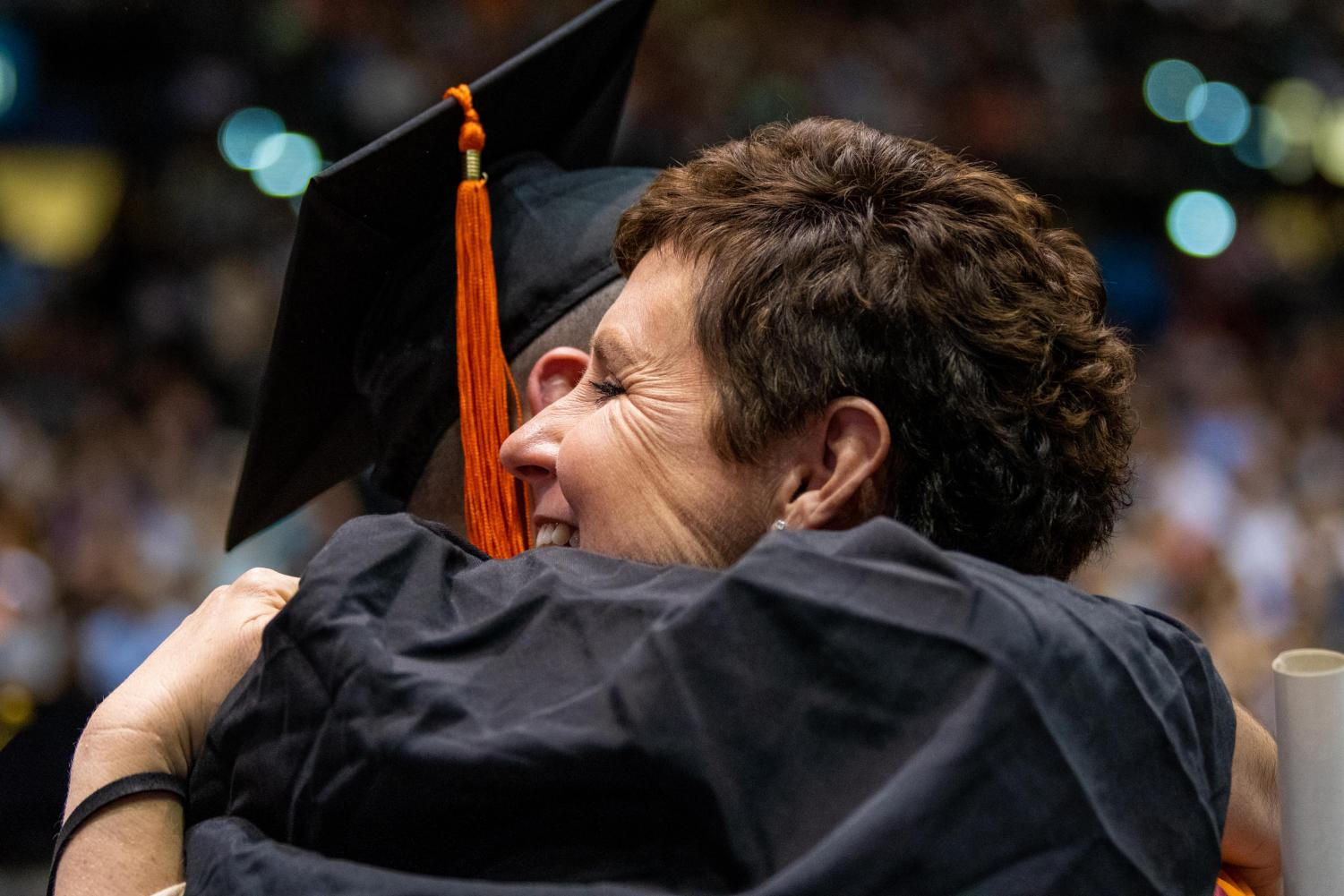After+receiving+diplomas+students+and+teachers+react+on+Saturday%2C+May+11%2C+2019+during+the+2019+commencement+inside+the+SIU+Arena.+