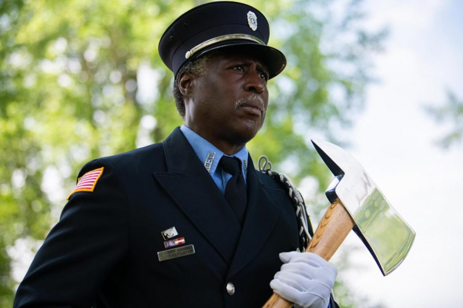 Murphysboro+Firefighter+Bobby+Alexander+carries+an+axe+on+Monday%2C+May+27%2C+2019+during+the+Carbondale+Memorial+Day+Service+at+Woodlawn+Cemetery+in+Carbondale%2C+Illinois.+
