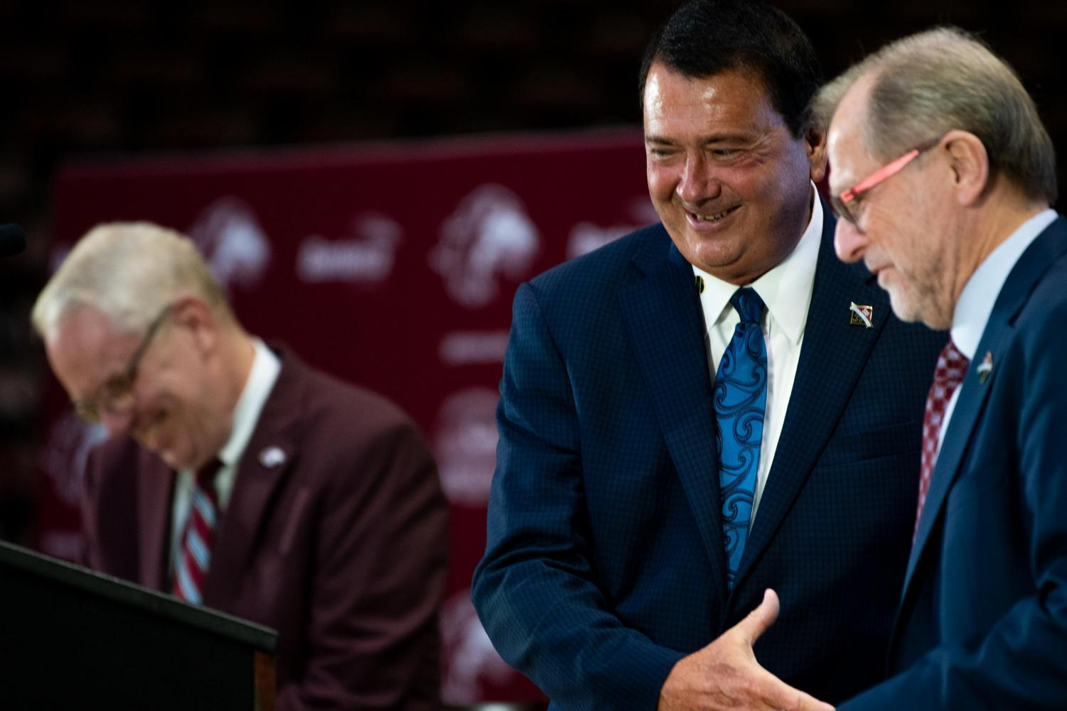 Interim Chancellor John Dunn and Jeff May, President and CEO of Banterra Bank shake hands on Thursday, March 16, 2019 during the press conference for the Arena naming-rights agreement inside the Banterra Center.