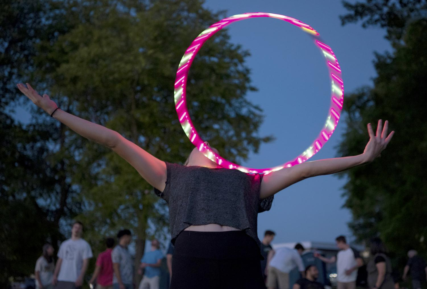 Megan+Wiese%2C+of+Mundelein%2C+rolls+a+hula+hoop+across+her+arms+on+Thursday%2C+June+20%2C+2019%2C+during+the+Sunset+Concert+at+Carbondale%E2%80%99s+Lenus+Turley+Park.+