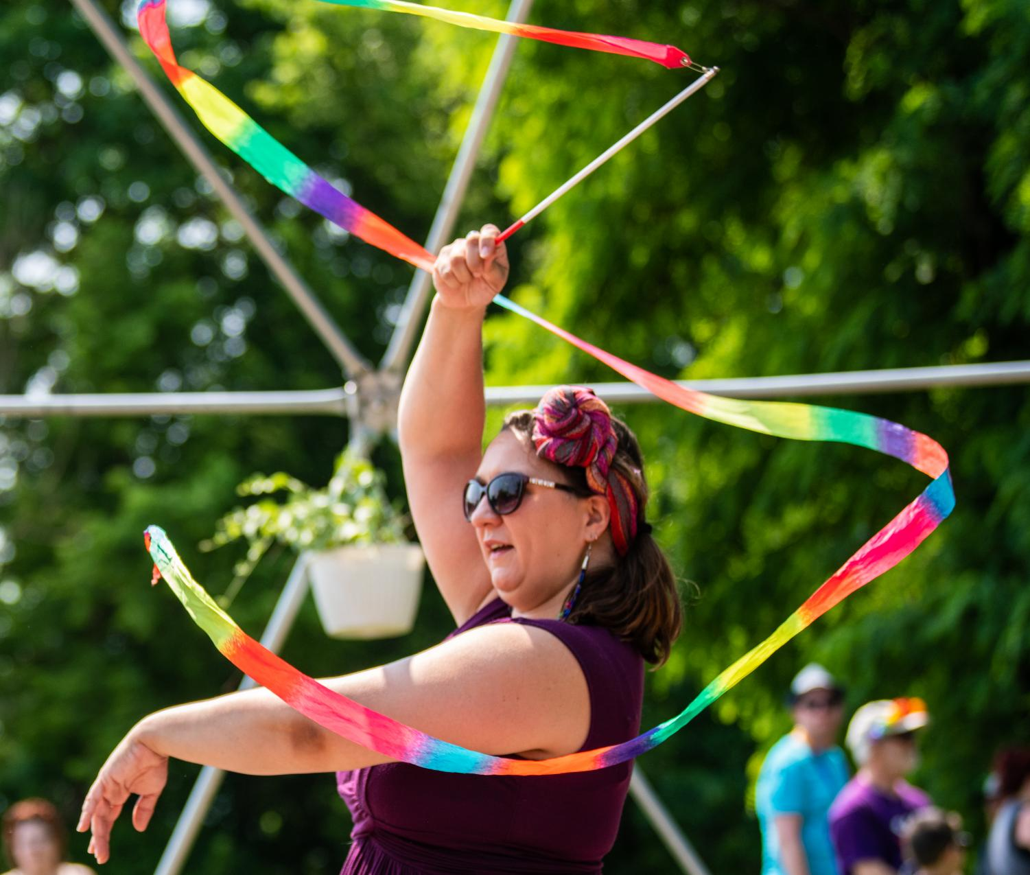 Bridget+Rose+twirls+with+a+ribbon+wand++inside+the+Labyrinth+Peace+Park+outside+the+Gaia+House+on+Saturday%2C+June+1%2C+2019+before+Carbondale%27s+second+annual+Pride+March.+Rose%2C+from+Carbondale%2C+came+to+the+event+with+her+six-year-old+Luca+Rose.+Rose+says+that+it+is+extremely+important+queer+community+to+come+together.+%22It%27s+not+a+hypothetical+for+us.+This+is+our+wellbeing%2C+our+lives%2C+us+being+able+to+love+each+other+and+ourselves%2C%22+Rose+said.+