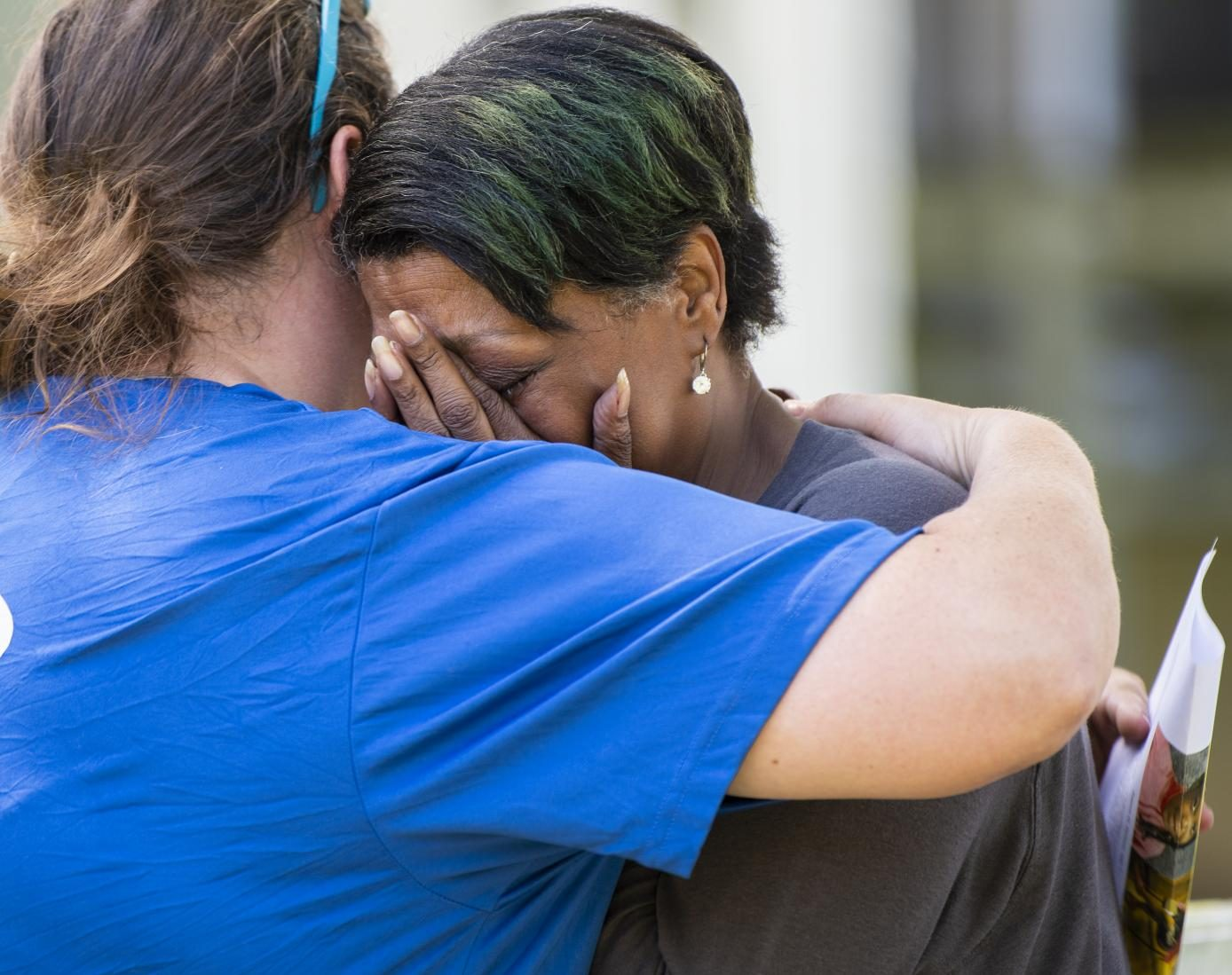 Patrice's grandmother Barbra Dotson shows emotion on Tuesday, June 11, 2019 on the corner of Rawlings Street and Cherry Street. Dotson came from Chicago to help look for her youngest grandchild