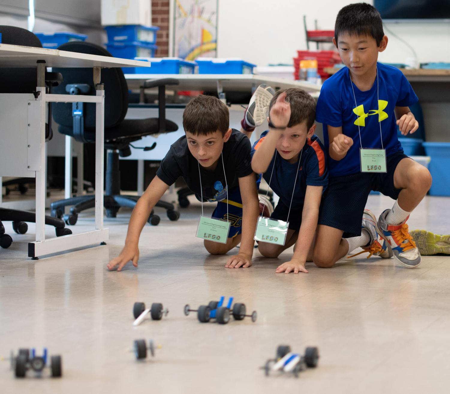 Children+race+their+cars+during+the+Advanced+Engineering+LEGO+Camp+on+Tuesday%2C+July+9%2C+2019+inside+Quigley+Hall.+The+camp+is+for+children+entering+3rd%2C+4th+and+5th+grade.+During+the+five+day+camp+children+will+complete+projects+that+explore+energy+supply%2C+transfer%2C+accumulation%2C+conversation+and+consumption.+Instructor+Nicholas+Lach+has+been+working+at+the+lego+camps+for+almost+a+decade.+He+enjoyed+instructing+the+camps+so+much+he+changed+his+career+to+teaching.