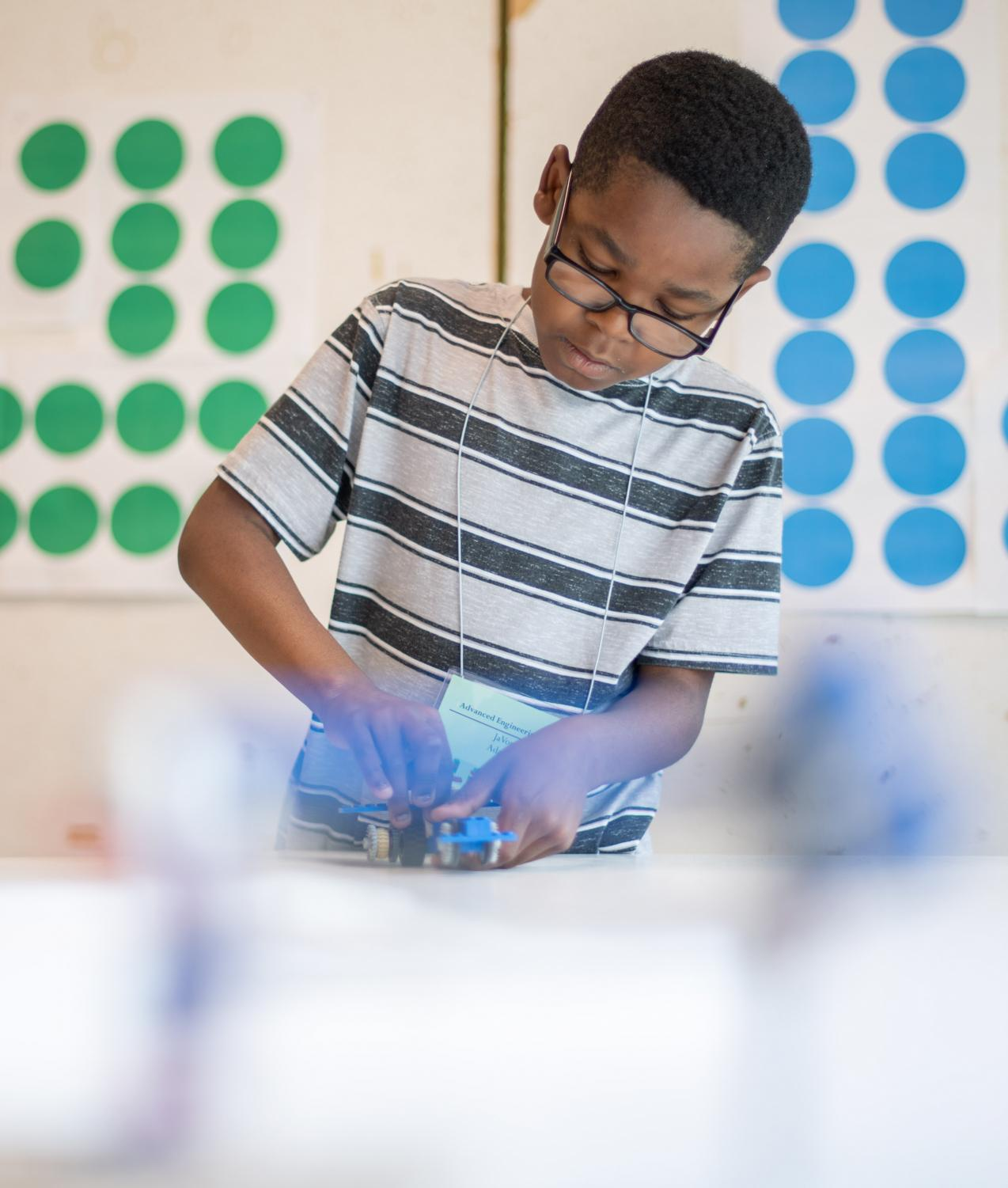 JaVon+Adams+works+on+his+LEGO+car+during+the+Advanced+Engineering+LEGO+Camp+on+Tuesday%2C+July+9%2C+2019+inside+Quigley+Hall.+The+camp+is+for+children+entering+3rd%2C+4th+and+5th+grade.+During+the+five+day+camp+children+will+complete+projects+that+explore+energy+supply%2C+transfer%2C+accumulation%2C+conversation+and+consumption.+Instructor+Nicholas+Lach+has+been+working+at+the+lego+camps+for+almost+a+decade.+He+enjoyed+instructing+the+camps+so+much+he+changed+his+career+to+teaching.