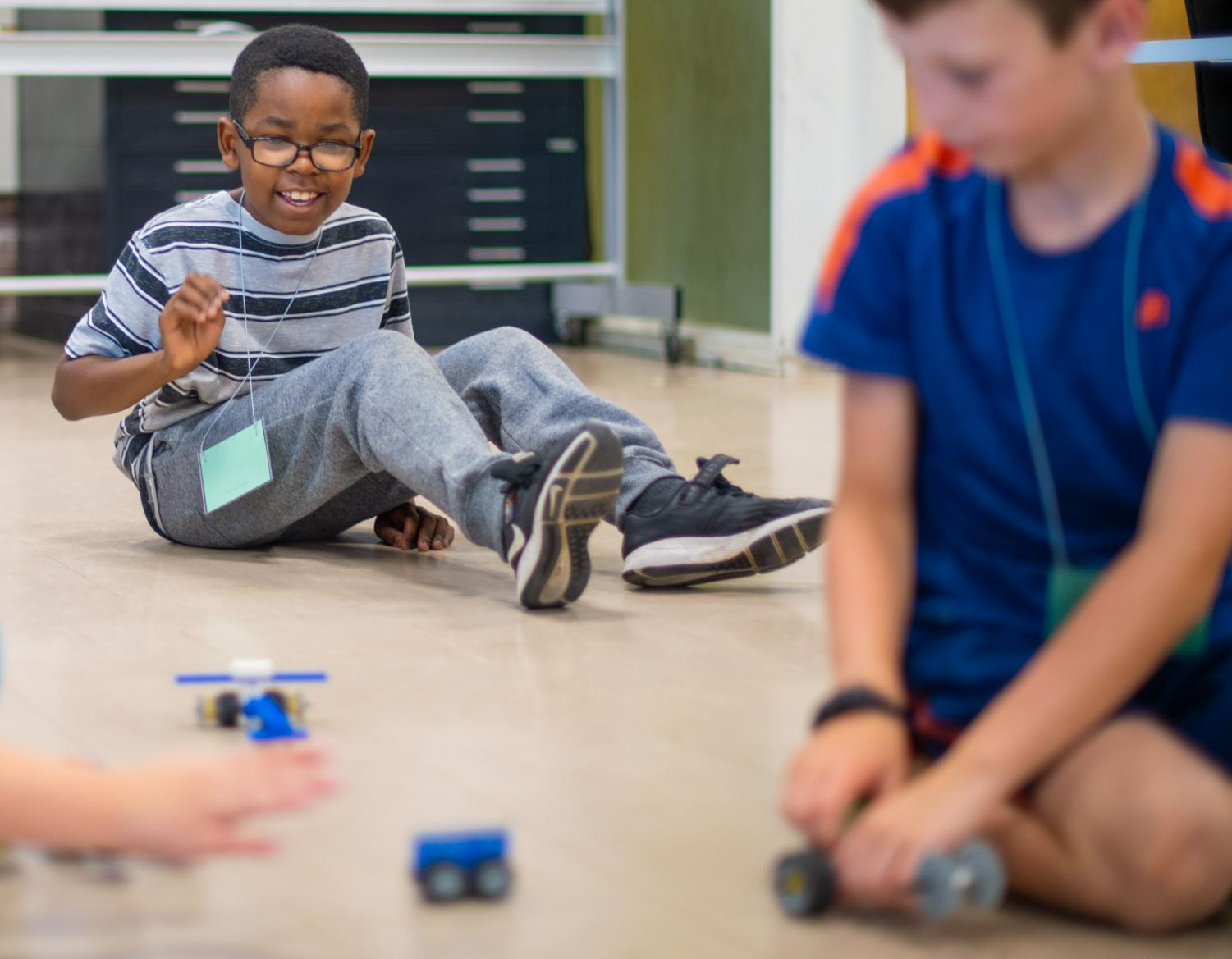 JaVon+Adams+races+his+LEGO+car+during+the+Advanced+Engineering+LEGO+Camp+on+Tuesday%2C+July+9%2C+2019+inside+Quigley+Hall.+The+camp+is+for+children+entering+3rd%2C+4th+and+5th+grade.+During+the+five+day+camp+children+will+complete+projects+that+explore+energy+supply%2C+transfer%2C+accumulation%2C+conversation+and+consumption.+