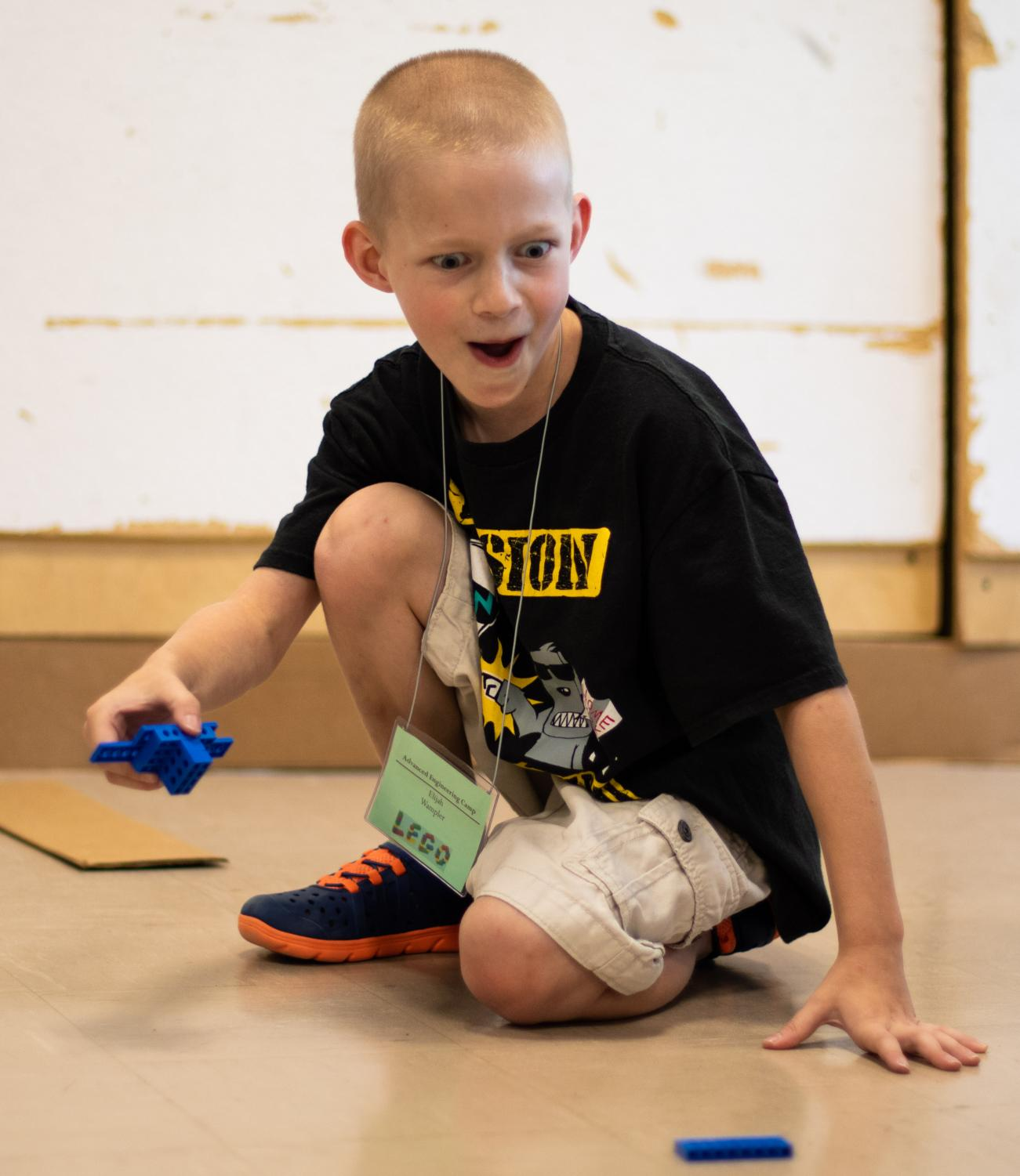 Elijah+Wampler+reacts+after+crashing+his+LEGO+car+during+the+Advanced+Engineering+LEGO+Camp+on+Tuesday%2C+July+9%2C+2019+inside+Quigley+Hall.+The+camp+is+for+children+entering+3rd%2C+4th+and+5th+grade.+During+the+five+day+camp+children+will+complete+projects+that+explore+energy+supply%2C+transfer%2C+accumulation%2C+conversation+and+consumption.+Jon+Davey%2C+the+project+director+for+LEGO+Camps%2C+his+goal+is+to+inspire+%E2%80%98young+people+to+be+creative+and+have+fun+while+learning.%E2%80%99