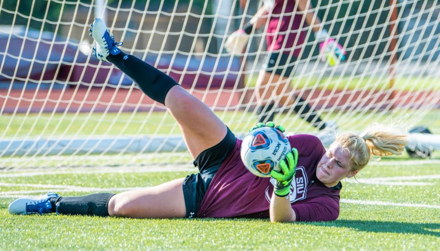 Freshman goalkeeper Maddy Alaluf catches the ball during their first practice on Wednesday, Aug. 7, 2019 at the Lew Hartzog Track & Field Complex.