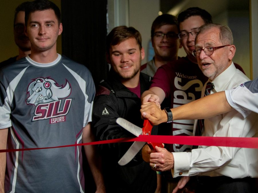Interim Chancellor John Dunn cuts the ribbon to open the SIU Esports Arena on Aug. 26, 2019 inside the Student Center.