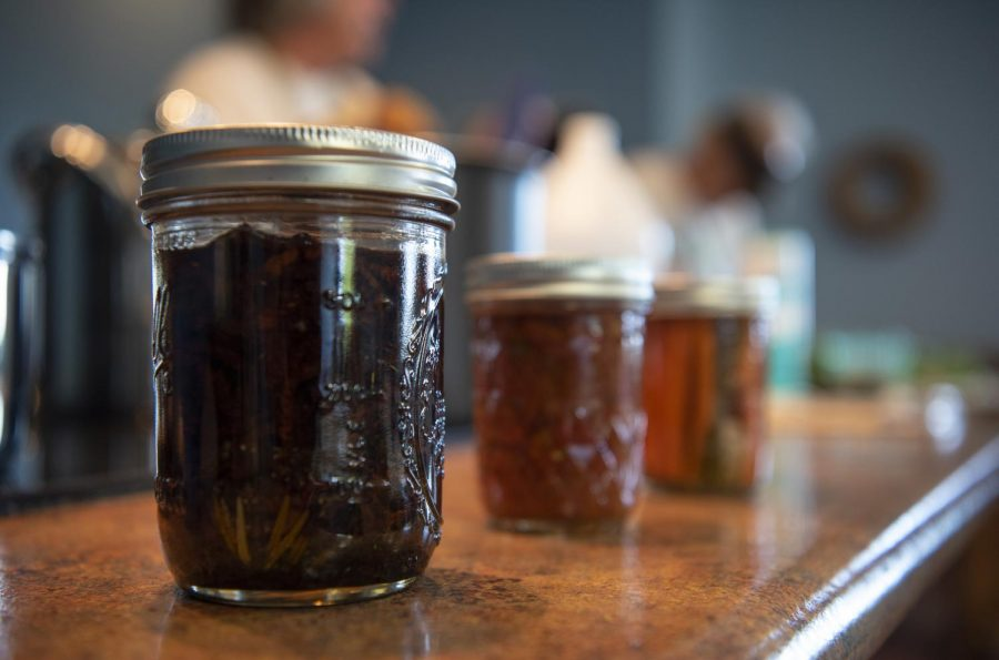 Ball jars filled with various vegetables and jams are put on display on Monday, Aug. 12, 2019, at an Intro To Canning demonstration at Kite Hill Vineyards in Etherton.