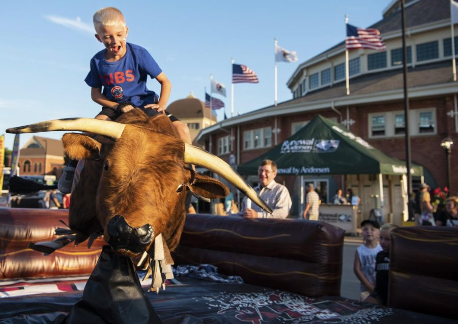 Jett Stollard, of Bethany, rides a mechanical bull on Saturday, Aug. 10, 2019, during the Illinois State Fair in Springfield, Illinois.