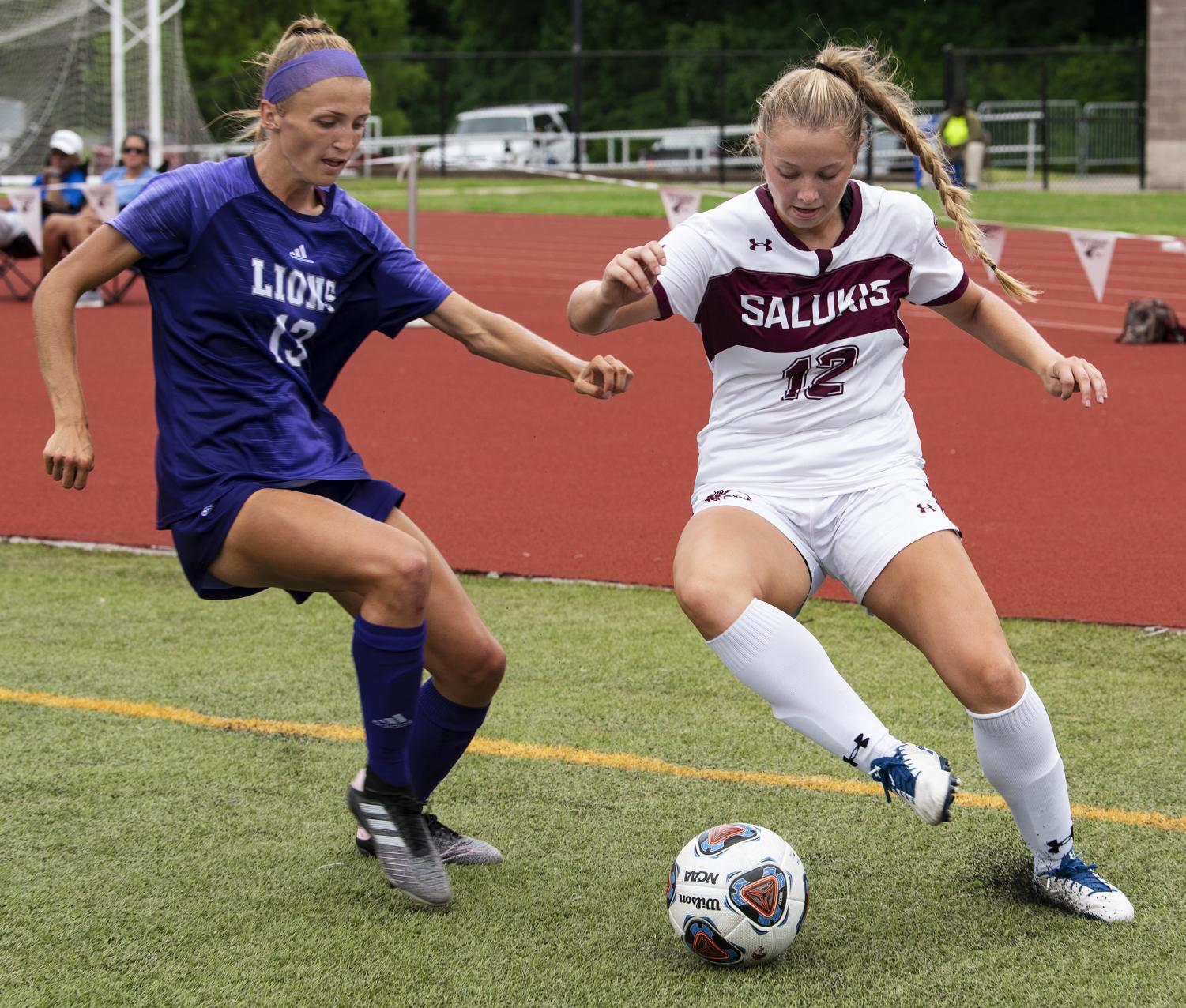 Madison Meiring, of Martinsville, Ind., protects the ball from a defender on Sunday, Aug. 25, 2019, at the SIU vs. North Alabama soccer game in Carbondale.