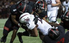 Saluki junior wide receiver Landon Lenoi gets tackled by multiple Redhawks on Aug. 29, 2019, during the Salukis' 26-44 loss against the Southeast Missouri State Redhawks  at the Houck Stadium in Cape Giradeau, Missouri.