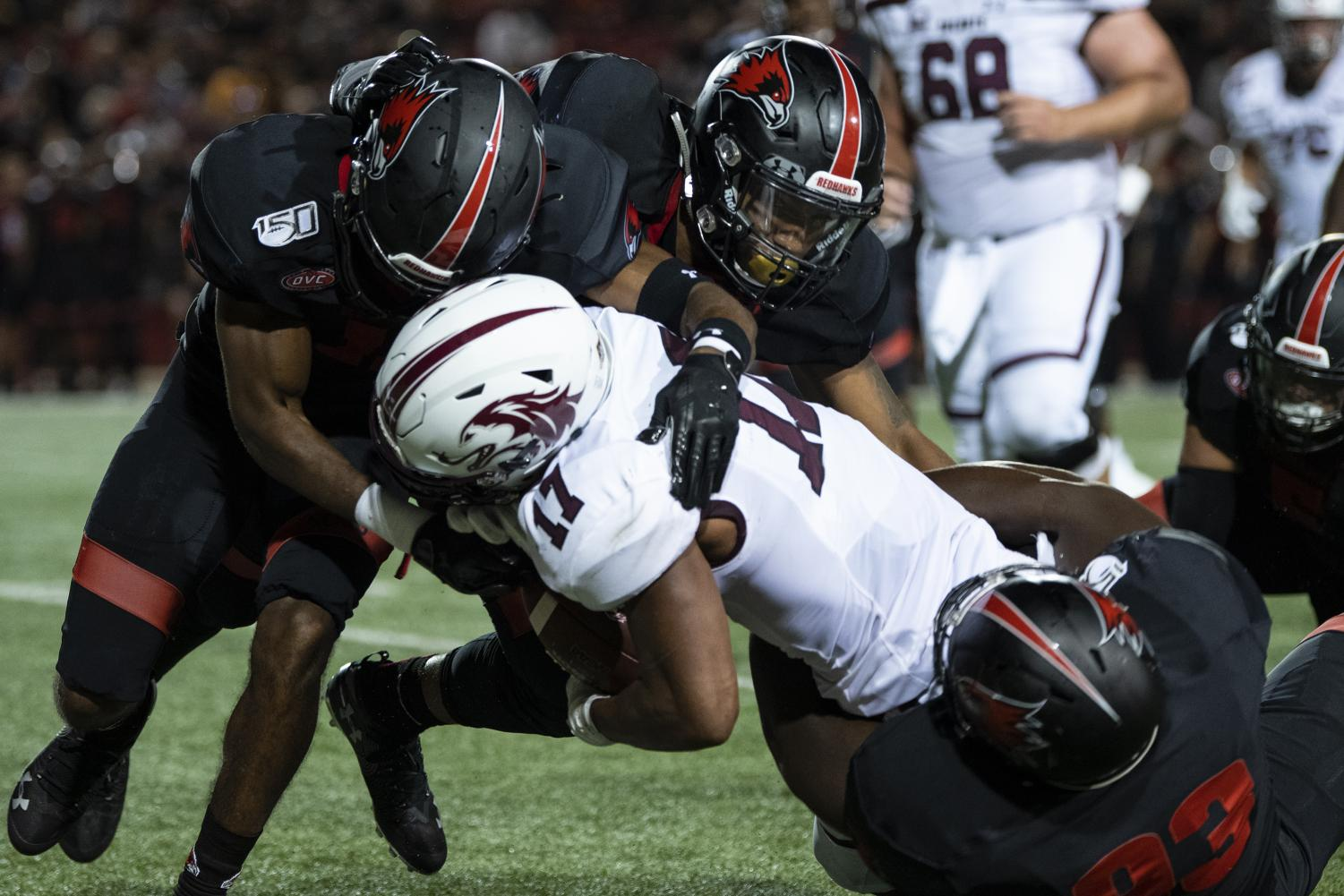 Saluki+junior+wide+receiver+Landon+Lenoi+gets+tackled+by+multiple+Redhawks+on+Aug.+29%2C+2019%2C+during+the+Salukis%27+26-44+loss+against+the+Southeast+Missouri+State+Redhawks++at+the+Houck+Stadium+in+Cape+Giradeau%2C+Missouri.+