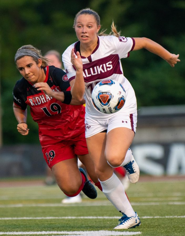 Saluki freshman Madison Meiring dribbles the ball forward on Saturday, Aug. 17, 2019 during the Salukis' 1-2 loss against the Southeast Missouri State University Redhawks at the Lew Hartzog Track & Field Complex.