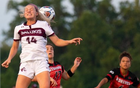 Saluki freshman Kaitlin DuCharme hits the ball on Saturday, Aug. 17, 2019 during the Salukis' 1-2 loss against the Southeast Missouri State University Redhawks at the Lew Hartzog Track & Field Complex.