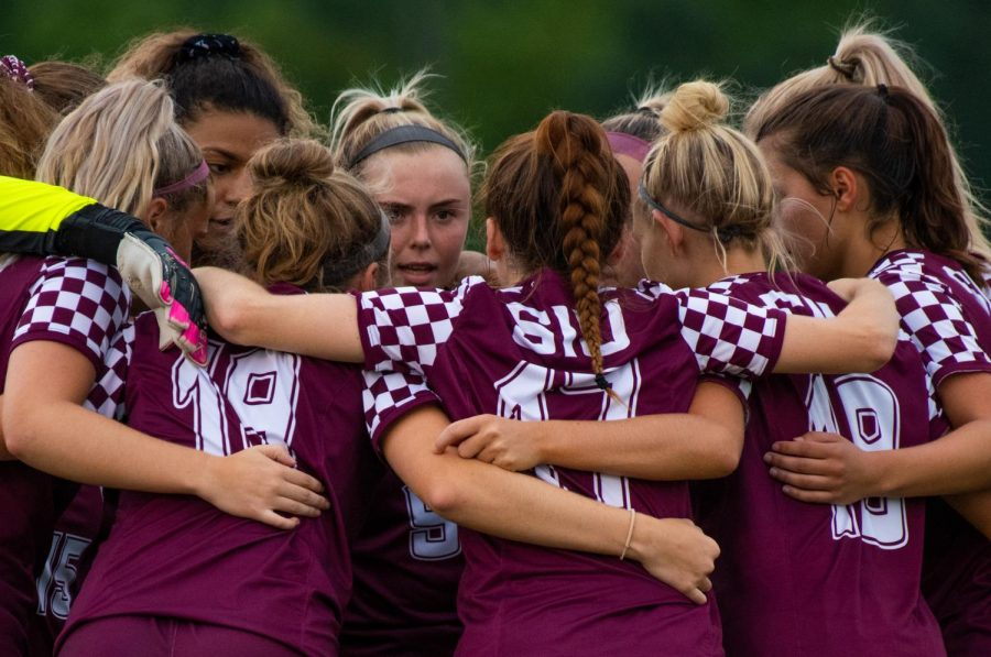 The Salukis huddle together before the game starts on Saturday, Aug. 23, 2019 before the Salukis' 2-0 win against the University of Illinois-Springfield Prairie Stars at the Lew Hartzog Track & Field Complex.
