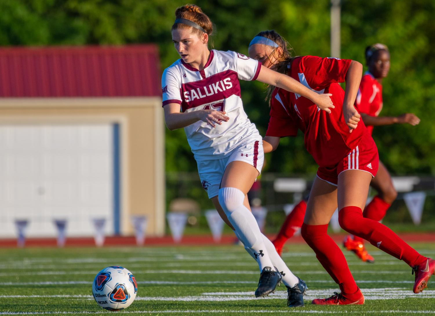 Saluki+freshman+Kathryn+Creedon+moves+the+ball+forward+on+Tuesday%2C+Aug.+27%2C+2019+during+the+Salukis%27+1-0+win+against+the+Rose-Hulman+Fightin%27+Engineers+at+the+Lew+Hartzog+Track+%26+Field+Complex.