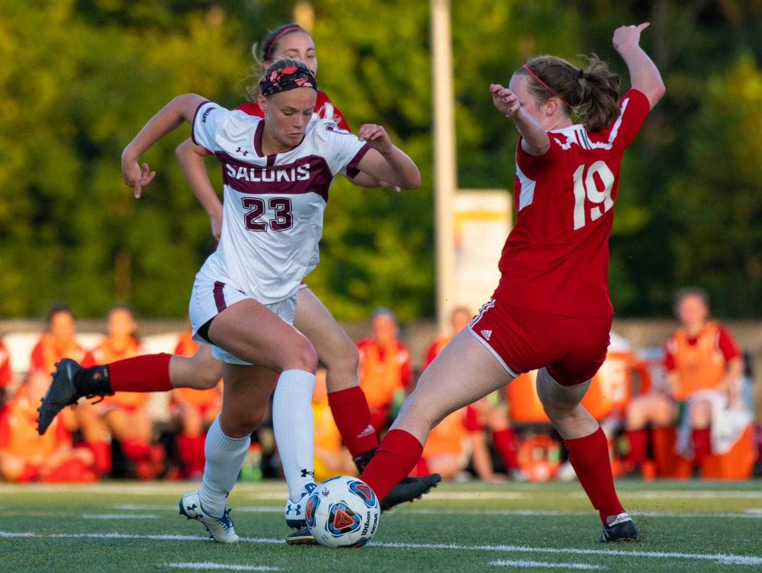 Saluki+freshman+Kaitlyn+Akers+kicks+the+ball+past+the+defense+on+Tuesday%2C+Aug.+27%2C+2019+during+the+Salukis%27+1-0+win+against+the+Rose-Hulman+Fightin%27+Engineers+at+the+Lew+Hartzog+Track+%26+Field+Complex.
