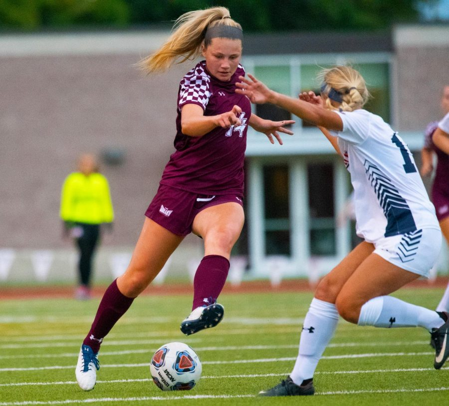 Kaitlin Ducharme kicks the ball on Friday, Aug. 30, 2019 during the Salukis' 1-0 win against the Belmont Bruins at the Lew Hartzog Track & Field Complex.