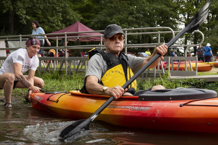 "Ray Liss, of Marion, is pushed onto the water on Saturday, Aug. 31, 2019, on Little Grassy Lake at SIU's Touch of Nature for the Team River Runner Southern Illinois Kickoff. Greg Nejmanowski, with SIU Veteran Adventures, says, ""Research has shown, and I've seen it with my own eyes, that [these events] help veterans with their life at home."""