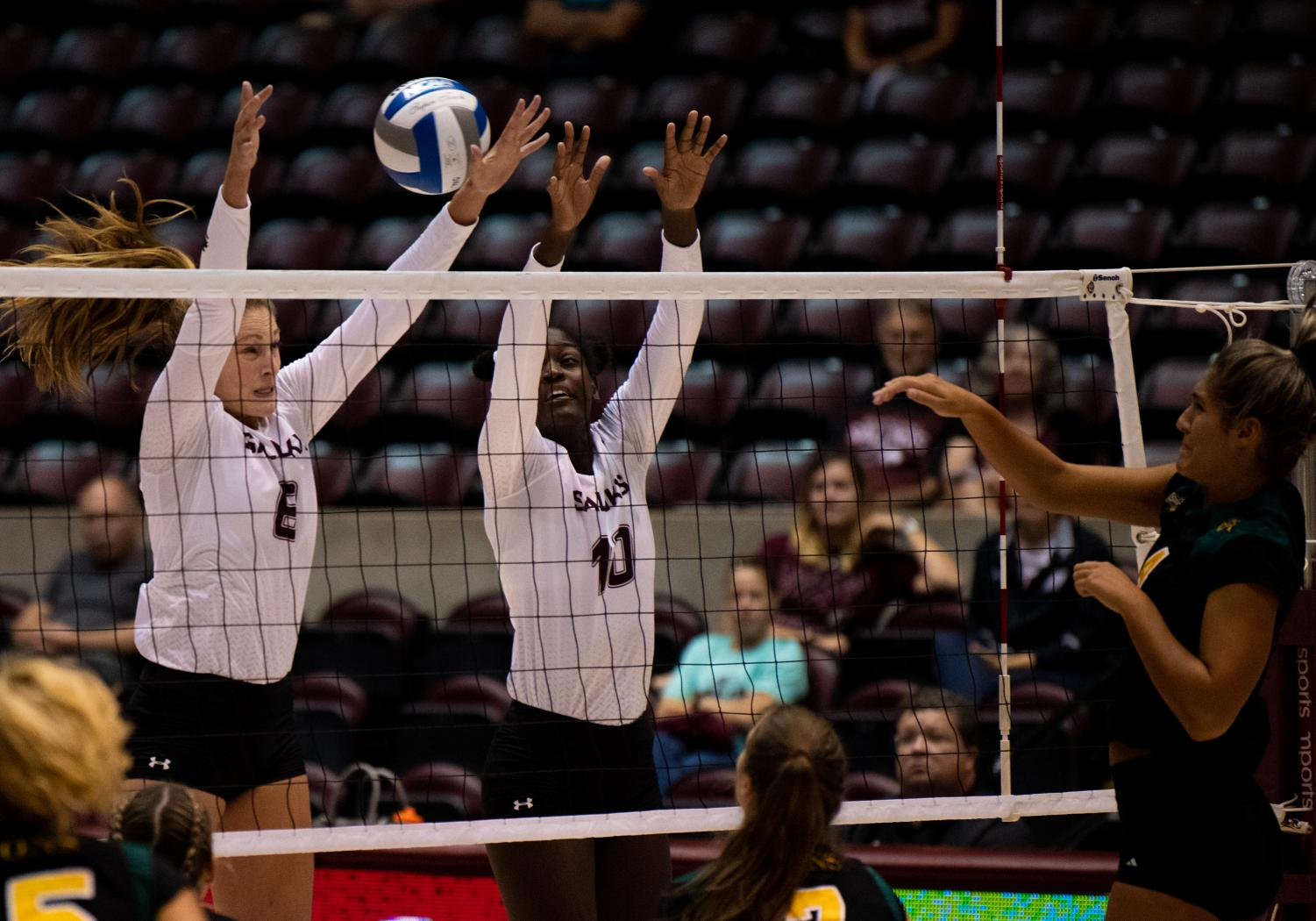 Salukis+Hannah+Becker+and+Savannah+Sheridan+attempt+to+block+the+ball+on+Saturday%2C+Sept.+7%2C+2019+during+the+Salukis%E2%80%99+3-1+win+against+the+Southeastern+Louisiana+University+Lions+at+the+Banterra+Center.+