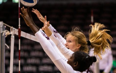 Salukis Hannah Becker and Savannah Sheridan attempt to block the ball on Saturday, Sept. 7, 2019 during the Salukis' 3-1 win against the Southeastern Louisiana University Lions at the Banterra Center.