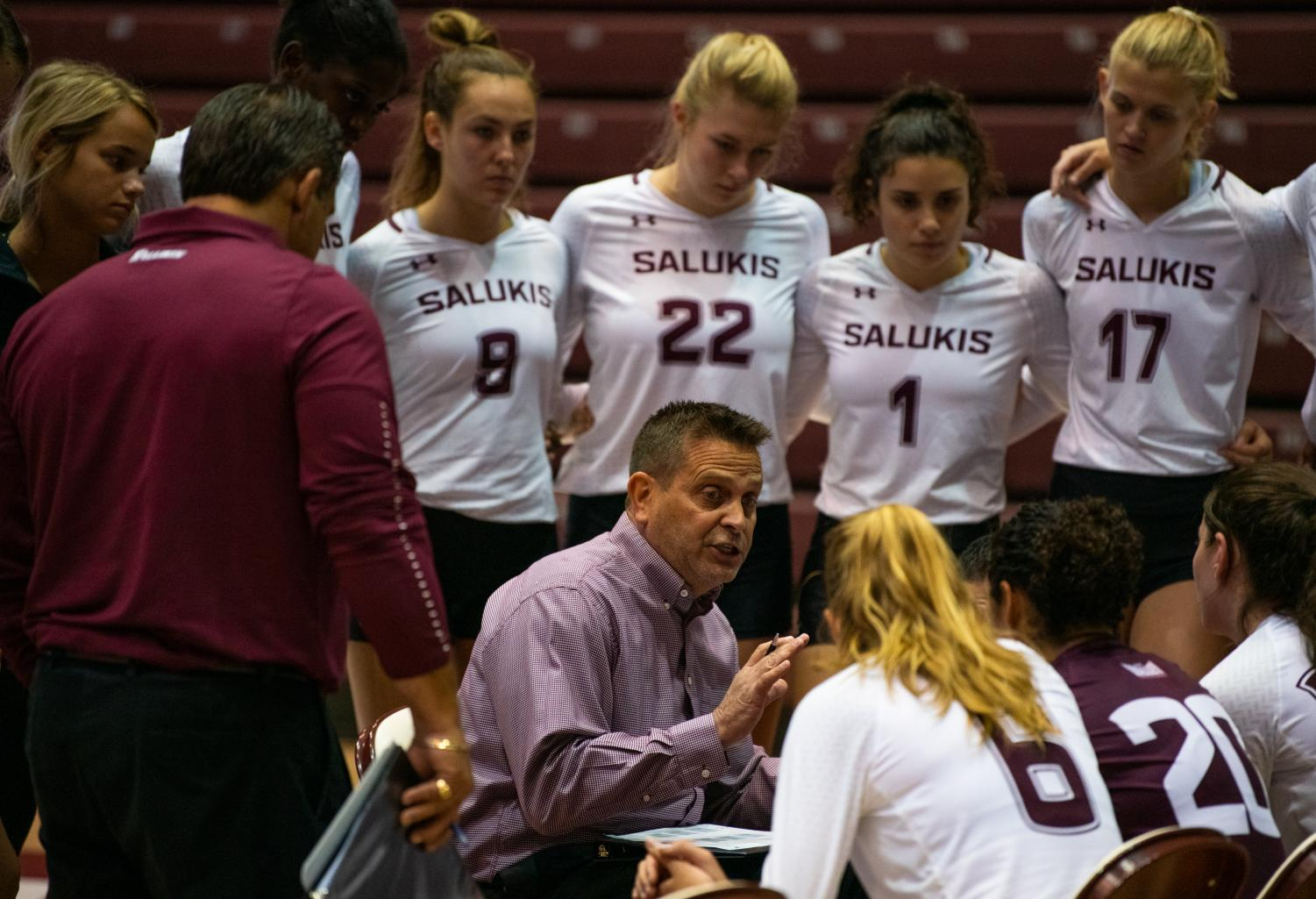 Head+Coach+Ed+Allen+speaks+to+the+team+during+a+time+out+on+Saturday%2C+Sept.+7%2C+2019+during+the+Salukis%E2%80%99+3-1+win+against+the+Southeastern+Louisiana+University+Lions+at+the+Banterra+Center.+