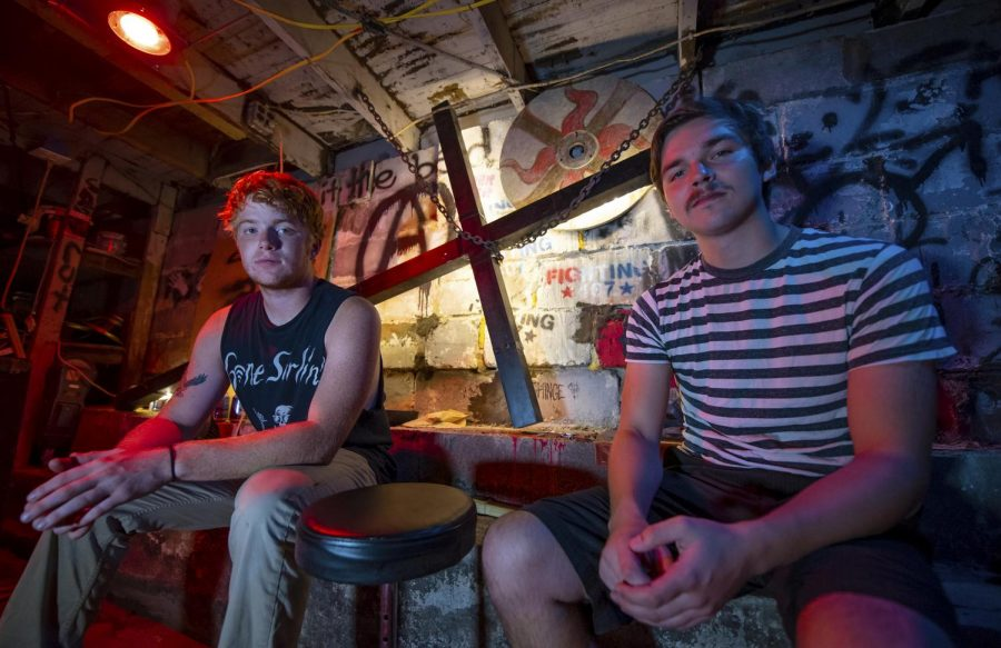 Residents of the Lost Cross house Morgan Hughes, left, of Marion, and Grant Kentala, right, of Chicago, pose for a portrait on Monday, Sept. 2019, inside the Lost Cross house basement. As the next owners of the punk house, Kentala says it's as if they have been passed the torch from previous generations.