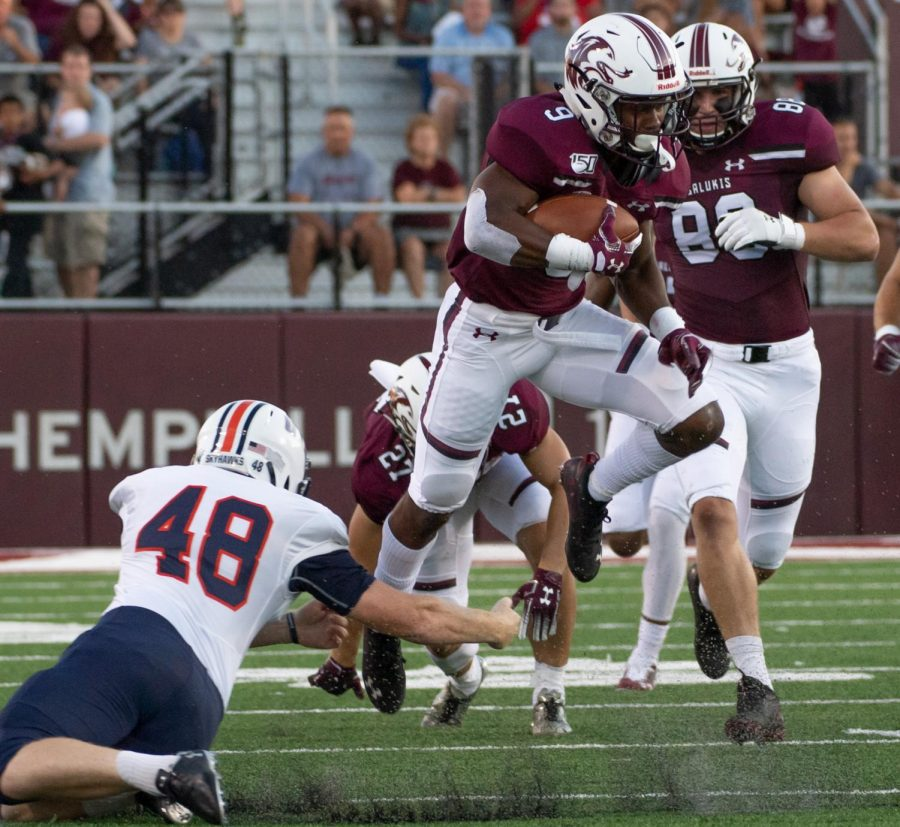 Saluki senior D.J. Davison runs the ball Saturday, Sept. 14, 2019 at SIU Arena during the Salukis' 28-14 win against the Tennessee-Martin Skyhawks.