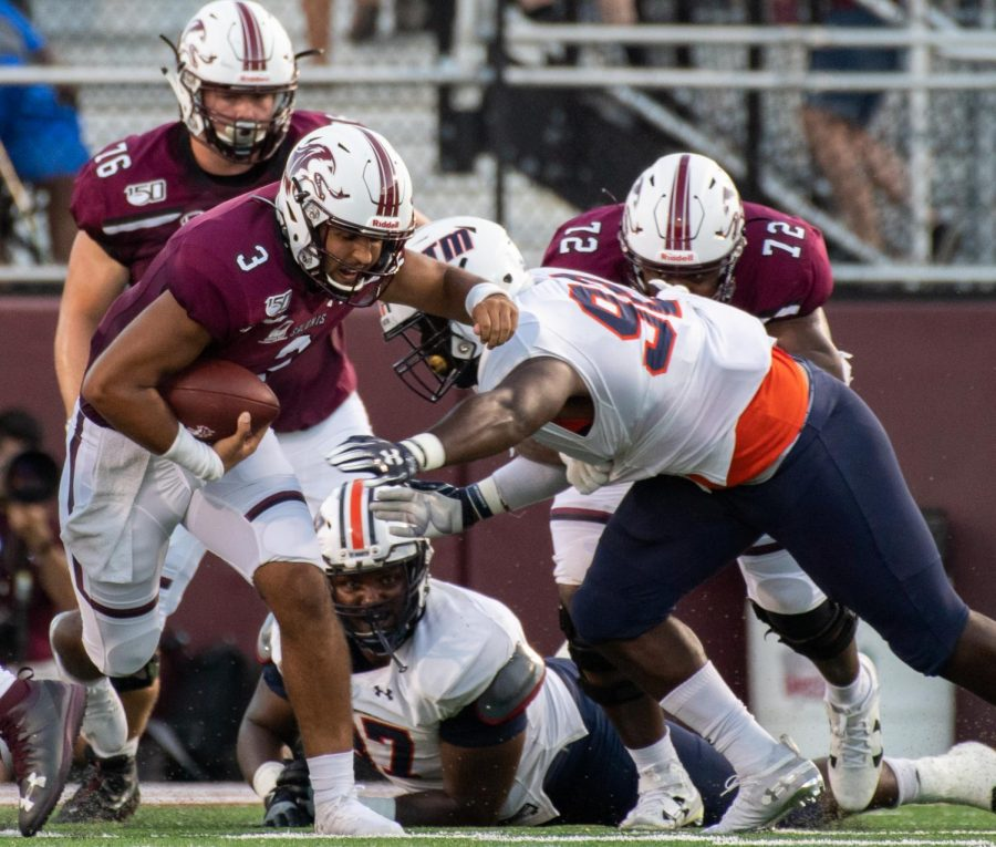 Saluki junior Karé Lyles protects the ball on Saturday, Sept. 14, 2019 at SIU Arena during the Salukis' 28-14 win against the Tennessee-Martin Skyhawks.