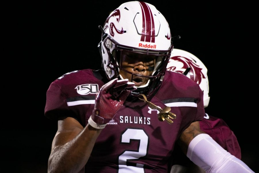 Saluki senior Jeremy Chinn celebrates on Saturday, Sept. 14, 2019 at SIU Arena during the Salukis' 28-14 win against the Tennessee-Martin Skyhawks.