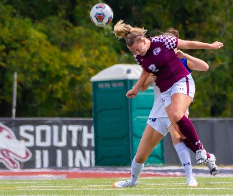 Saluki freshman Madison Bennion heads the ball on Sunday, Sept. 15, 2019 during the Salukis