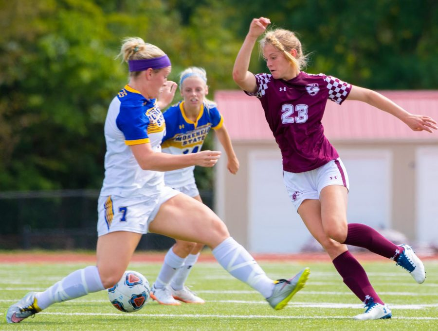 Saluki freshman Kaitlyn Akers attempts to block the ball on Sunday, Sept. 15, 2019 during the Salukis' 2-1 win in overtime against the Morehead State Eagles at the Lew Hartzog Track & Field Complex.