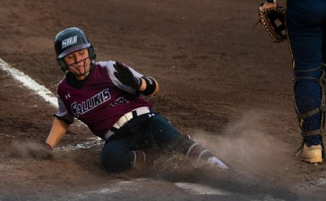 Saluki outfielder Aubree Depron slides into home base on Saturday, Sept. 21, 2019 during the Salukis