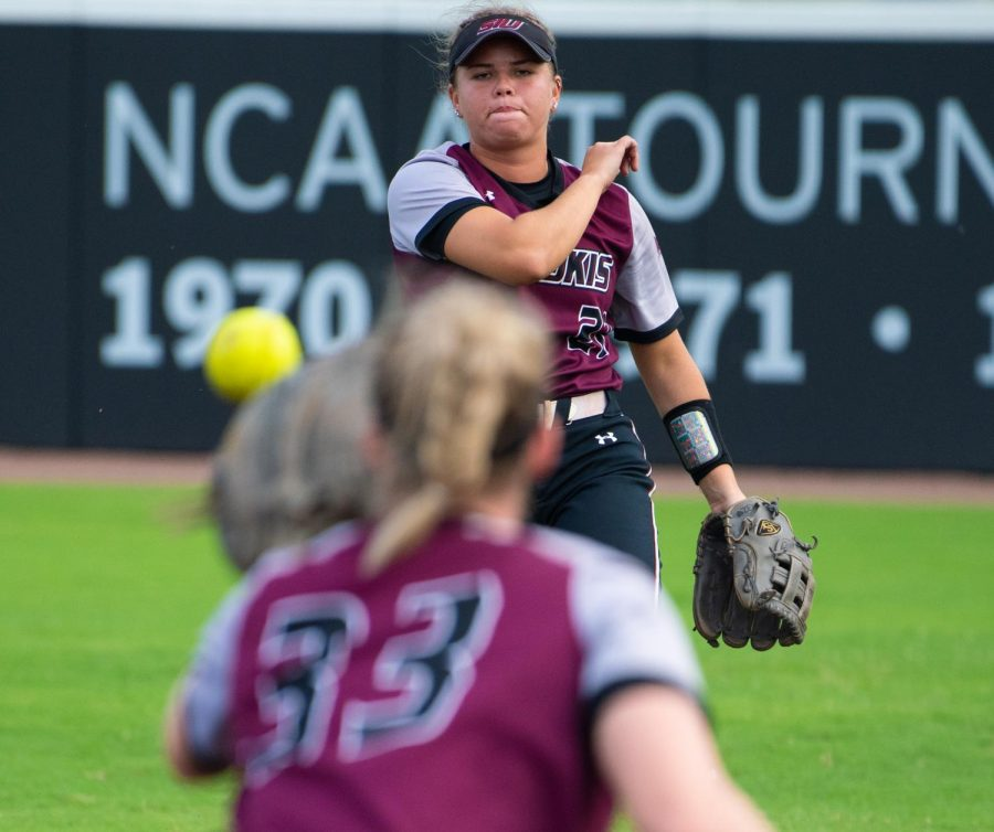 Saluki Infielder Maddy Vermejan passes the ball on Saturday, Sept. 21, 2019 during the Salukis' 4-0 win against the Murray State Racers at Charlotte West Stadium.