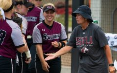 Head Coach Kerri Blaylock talks to the team on Saturday, Sept. 21, 2019 during the Salukis' 4-0 win against the Murray State Racers at Charlotte West Stadium.