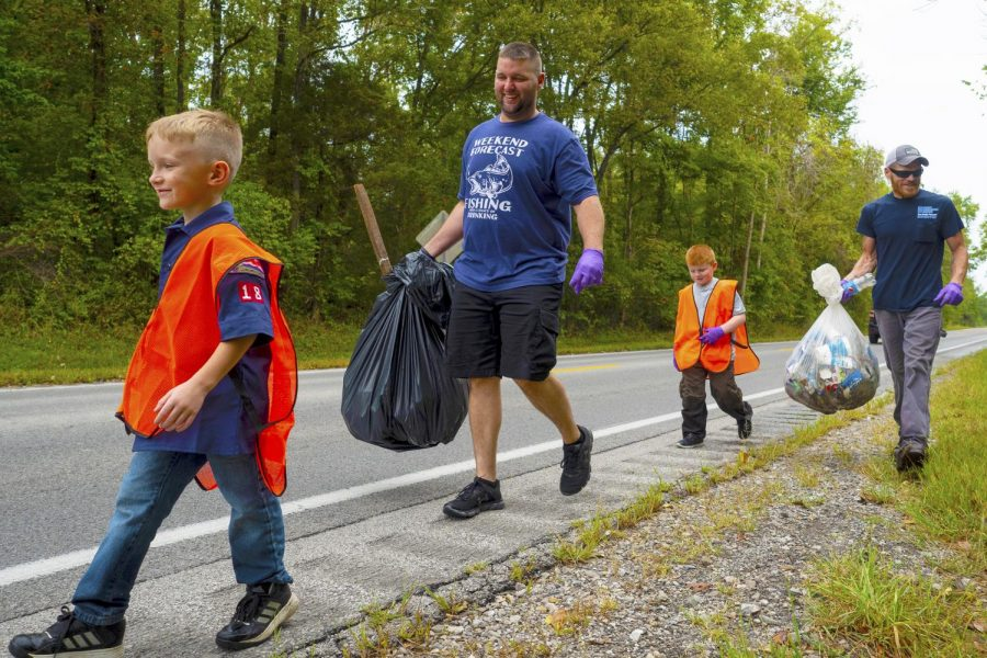 Colt and Josh Walden, Ryker Johnson, and Steven Beers walk along the side of Spillway Road collecting trash on Saturday, Sept. 12, 2019, during the Crab Orchard National Wildlife Refuge Cleanup.