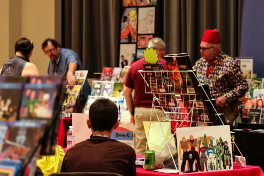 Attendees walk through the rows of booths on Saturday, Sept 28, 2019 during SalukiCon.