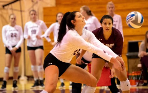 Saluki junior setter Rachel Maguire passes the ball on Tuesday, Sept. 17, 2019 during the Salukis' 3-2 win against UT Martin Skyhawks at Davies Gym.