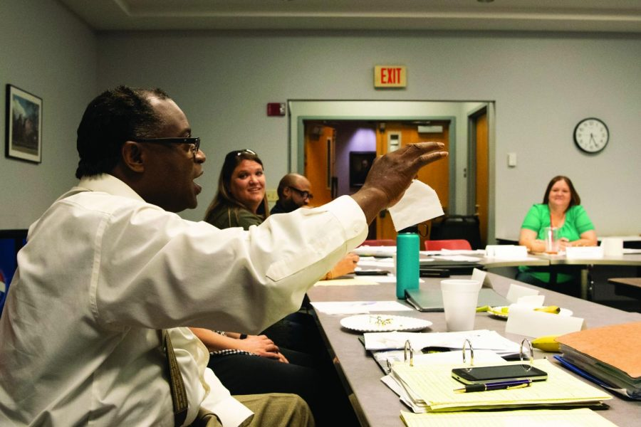 Carbondale Human Relations Commissioner Karriem Shariati holds up a piece of toilet paper during an icebreaker exercise at the HRC retreat on Monday, Sept. 9, 2019.