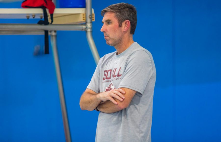 Swimming+and+Diving+Head+Coach+Rick+Walker+watches+the+swim+team+practice+on+Wednesday%2C+Sept.+17.+2019+inside+the+Dr.+Shea+Auditorium.