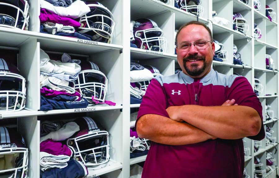 SIU Director of Equipment, Andrew Harris, poses for a portrait on Wednesday, Sept. 25, 2019 in the SIU Football lockerroom.